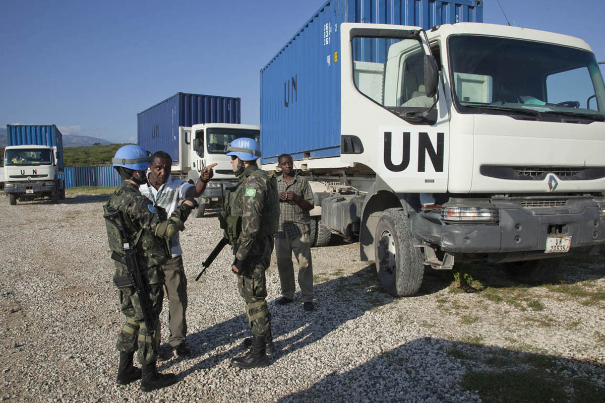 Brazilian troops arrive to escort a convoy of trucks carrying electoral materials as they depart Port au Prince to nine regions throughout Haiti.