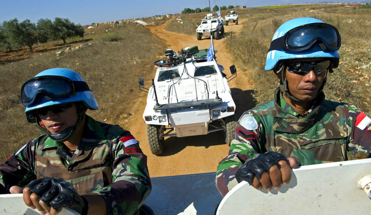 Indonesian and French peacekeepers on a vehicle joint patrol passing trough a UN Post near the town of Taybe, South Lebanon.