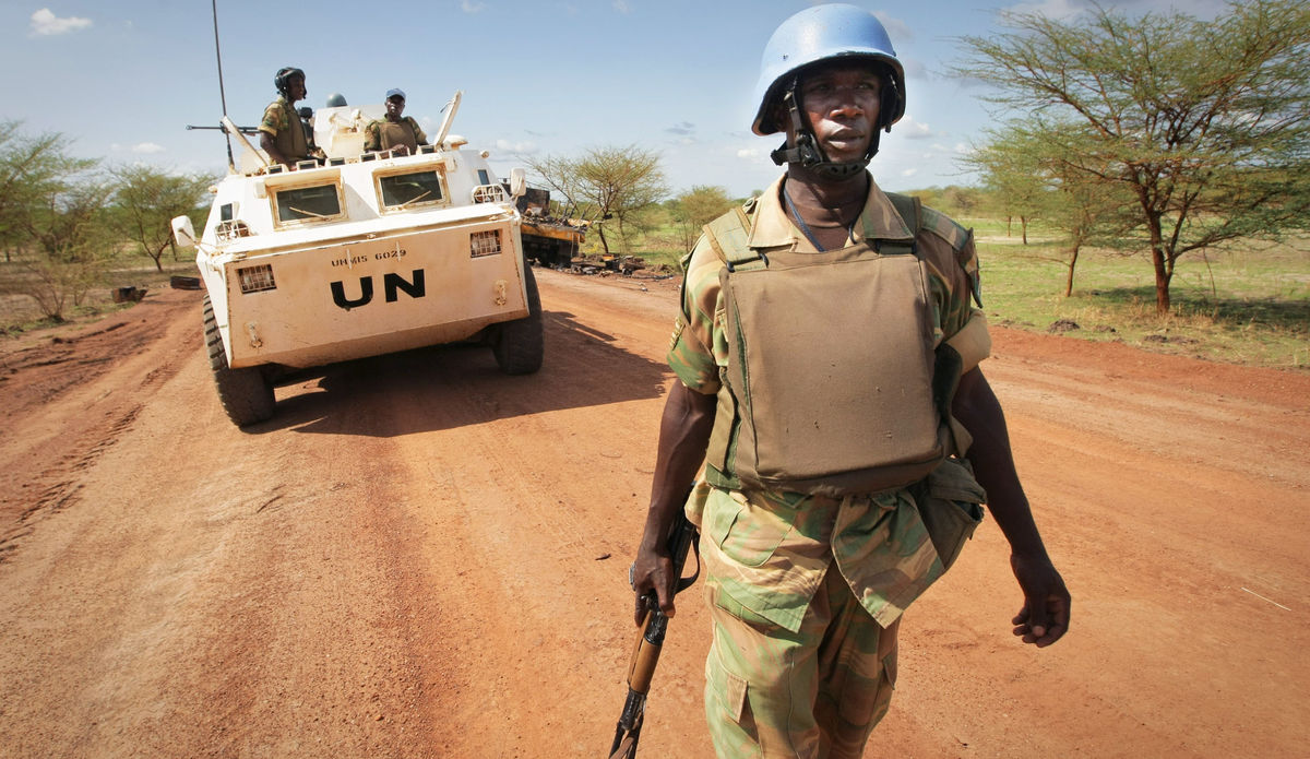 A soldier from Zambia serving with the international peacekeeping operation on the ground during a patrol in the volatile region of Abyei, central Sudan.
