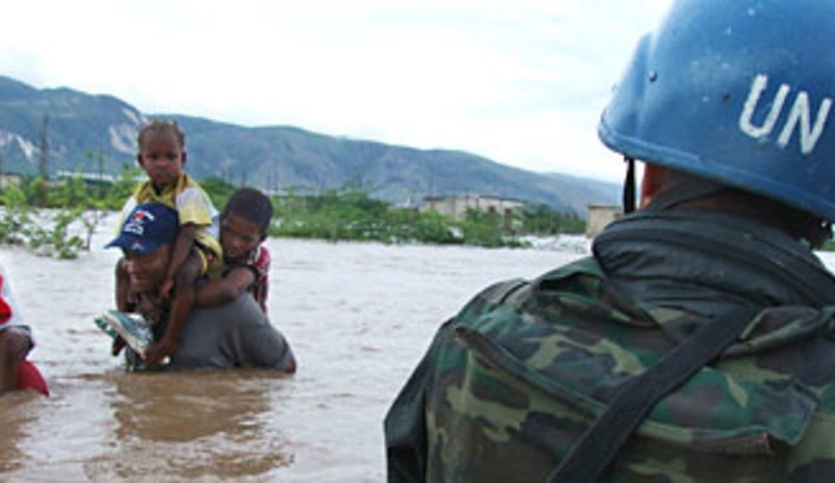 Members of the Jordanian battalion in Haiti assist in rescuing children, after a hurricane destroyed their orphanage.