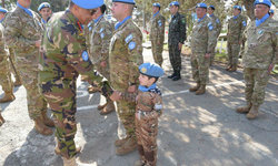 Major General Humayun of Bangladesh, Force Commander of UN Peacekeeping Force in Cyprus (UNFICYP) shaking hands of boy (UN peacekeeper-in-training) at sector 1 medal parade on 31 January 2018, Cyprus.  Photo: UNFICYP/Robert Schütz