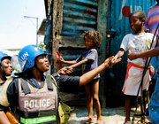 Nigerian FPU Officers speak with children as they patrol the slum of Martissant