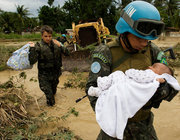 MINUSTAH also worked to help Haitians during a number of natural disasters over the past 13 years, including heavy rains from tropical storm Noel in 2007, which left thousands of people homeless. Above, a Brazilian UN peacekeeper rescues a baby and his family from a flooded home in Cite Soleil.